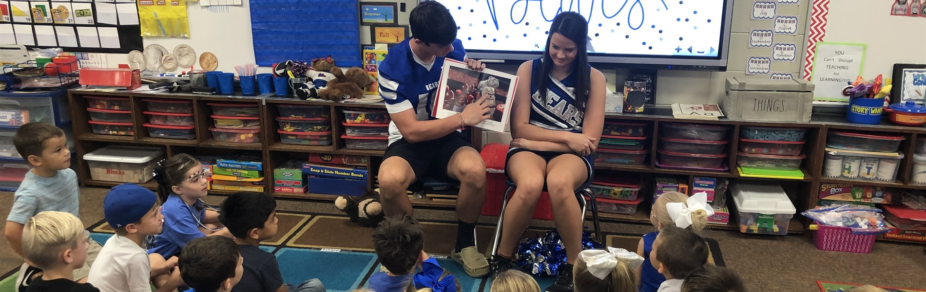 PCHS Bears read to MES students.