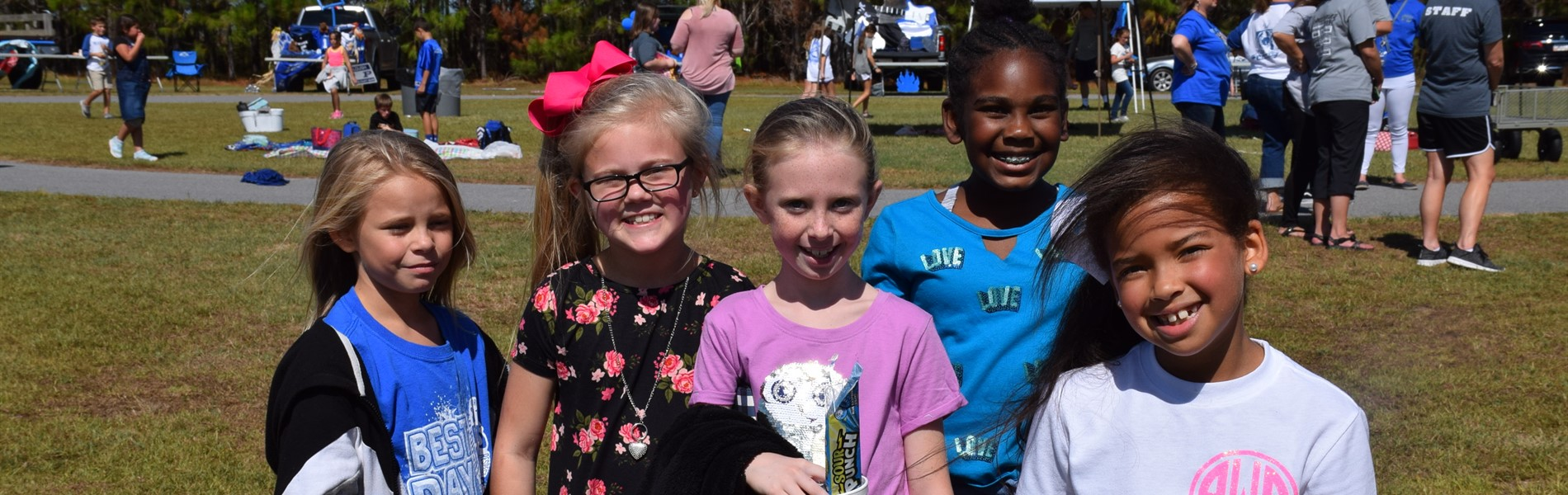 Children enjoying the sunshine and activities of the PBIS celebration.
